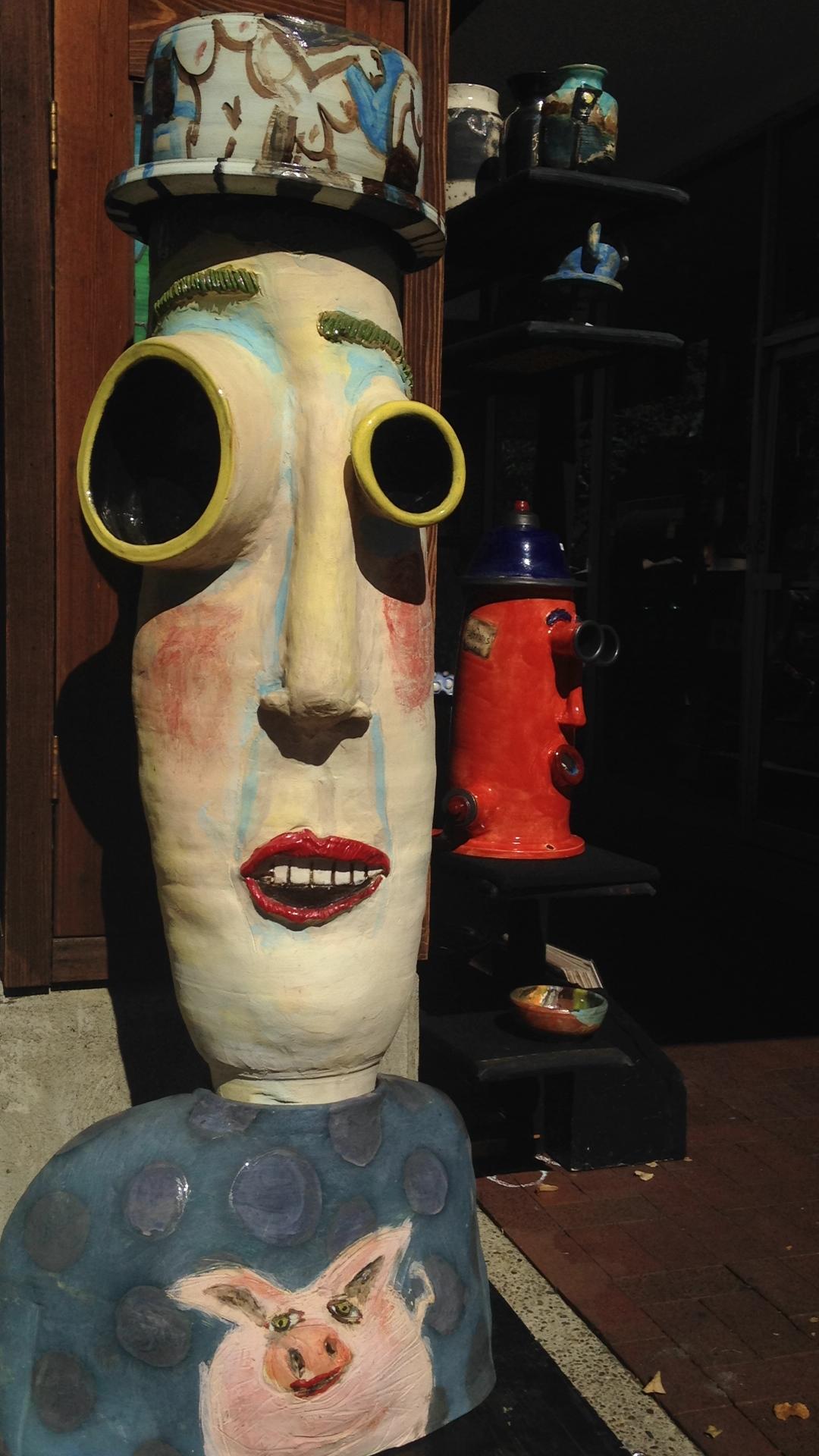 Chris Efstraris's ceramic sculpture grins at pedestrians at the Menlo Park Fine Arts & Crafts Fall Fest on Oct. 5, 2014 in Menlo Park, Calif. (Miranda Shepherd/Peninsula Press)