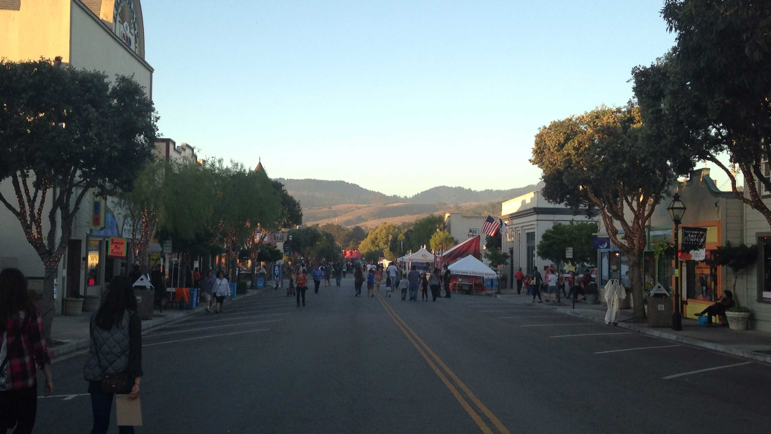 The sun sets on Half Moon Bay's Main Street at the 44th annual Art and Pumpkin Festival on Saturday October 18, 2014. (Miranda Shepherd/Peninsula Press)