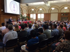 Doug Owens, the Director of the Center of Health Policy (CHP) in the Freeman Spogli Institute for International Studies, addresses a captivated audience about the Ebola outbreak in West Africa, during a talk at Stanford University. The public event, which took place on Tuesday, Sept. 23, 2014, featured six expert panelists who discussed the health, governance and ethical challenges posed by the Ebola virus. (Austin Meyer/Peninsula Press)