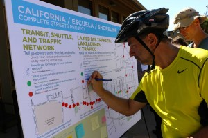 Mountain View resident Ricardo Gonzalez gives input on a community map noting locations where they hope to see neighborhood improvements for pedestrians, bikers and drivers in Mountain View, Calif., on Saturday, Sept. 27, 2014. (Carolina Wilson/Peninsula Press)