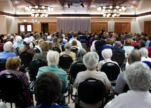 """A record-breaking 220 senior citizens packed the San Carlos Adult Community Center for a """"Senior Scam Stoppers"""" seminar on Friday, October 3, 2014 – the largest turnout for a San Mateo County scam event in recent memory. The seminar was offered by Assemblymember Kevin Mullin (D-San Mateo) in an effort to educate senior citizens on how to identify current scams and protect themselves against fraud. (Katie Straub/Peninsula Press)"""
