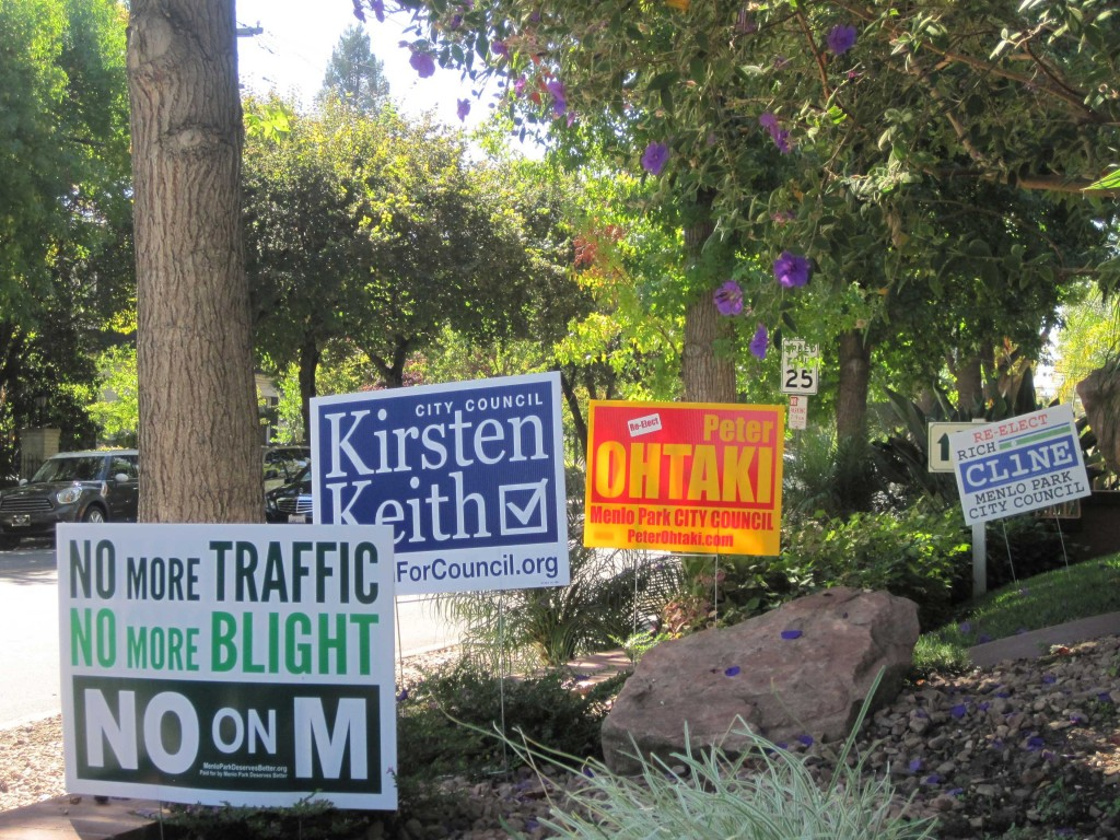 Signs for and against Measure M blanketed Menlo Park in the weeks ahead of the election. Voters rejected Measure M, which would have imposed further limits on future office buildings downtown (Farida Jhabvala Romero/Peninsula Press).