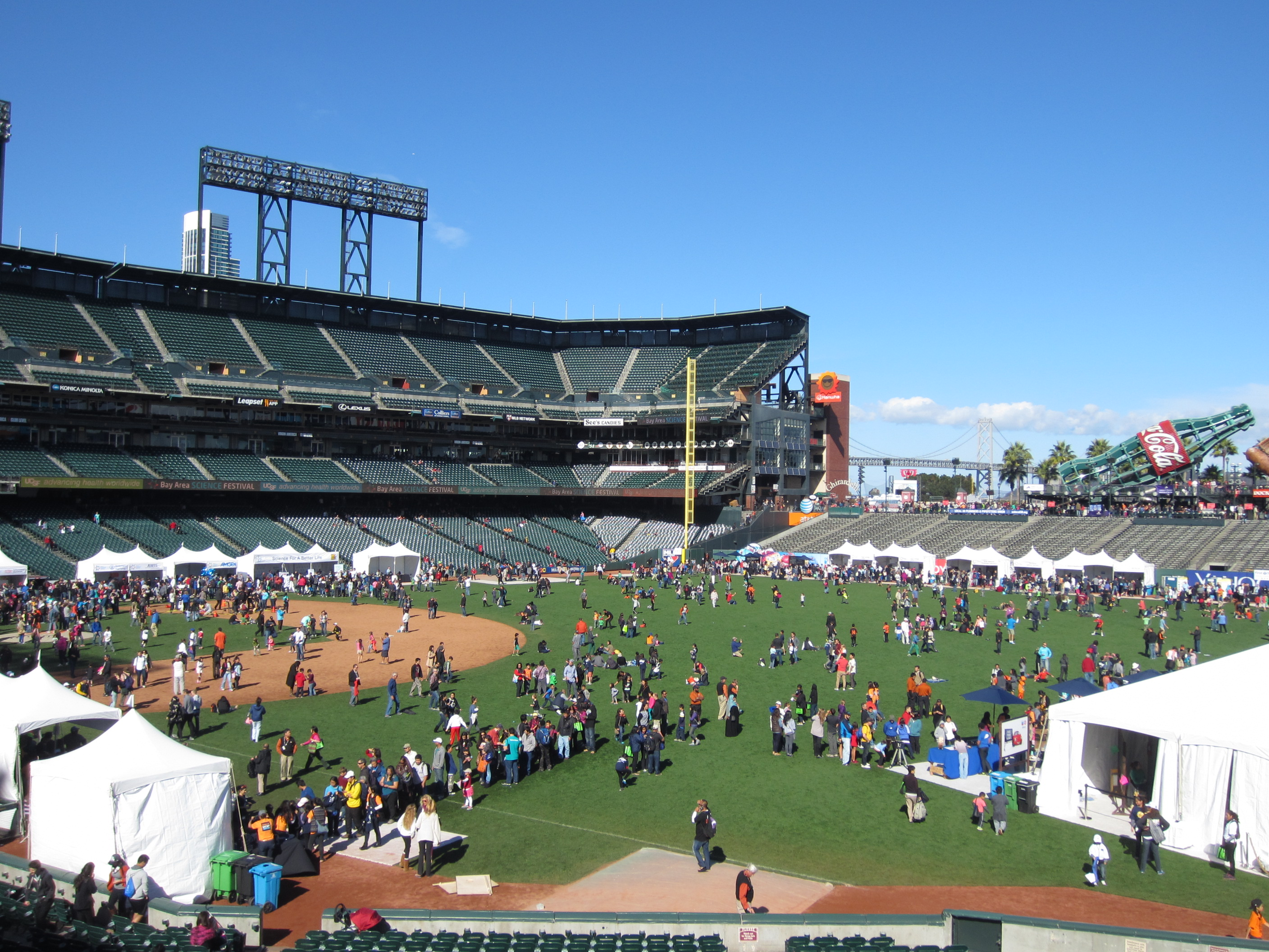 On Nov. 1, 2014, AT&T park was filled with more than 150 interactive science and technology exhibits for Discovery Day, the last event of the 4th annual Bay Area Science Festival. The exhibits are run by Bay Area organizations. Last year, 30,000 people attended, and the stadium was again buzzing with crowds on Saturday. (Shara Tonn/Peninsula Press)