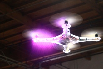 A transparent drone built for combat takes flight as a match begins. (Phoebe Barghouty/Peninsula Press)