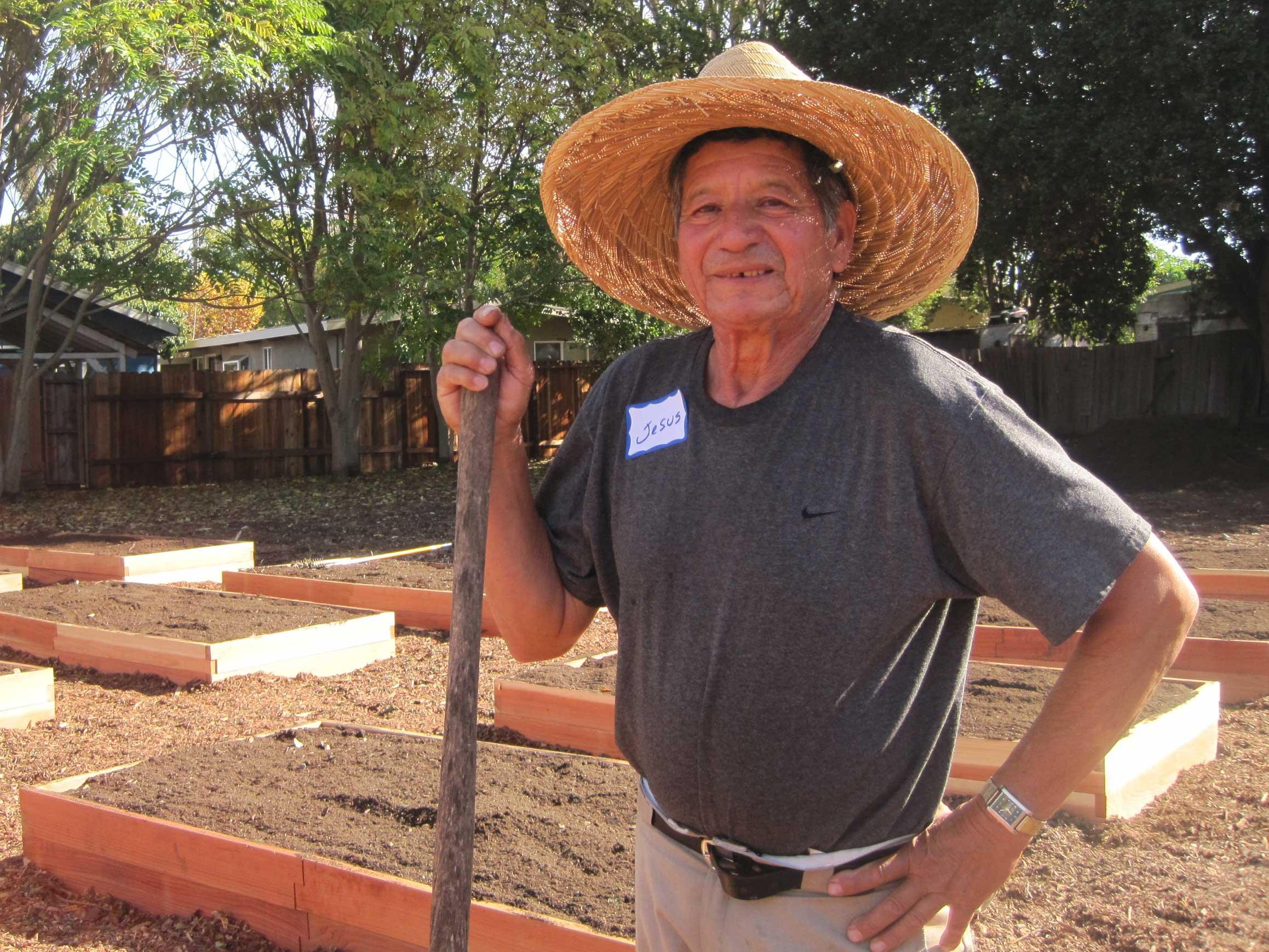 jesus becerra helps build belle havens first community garden on nov 8 2014