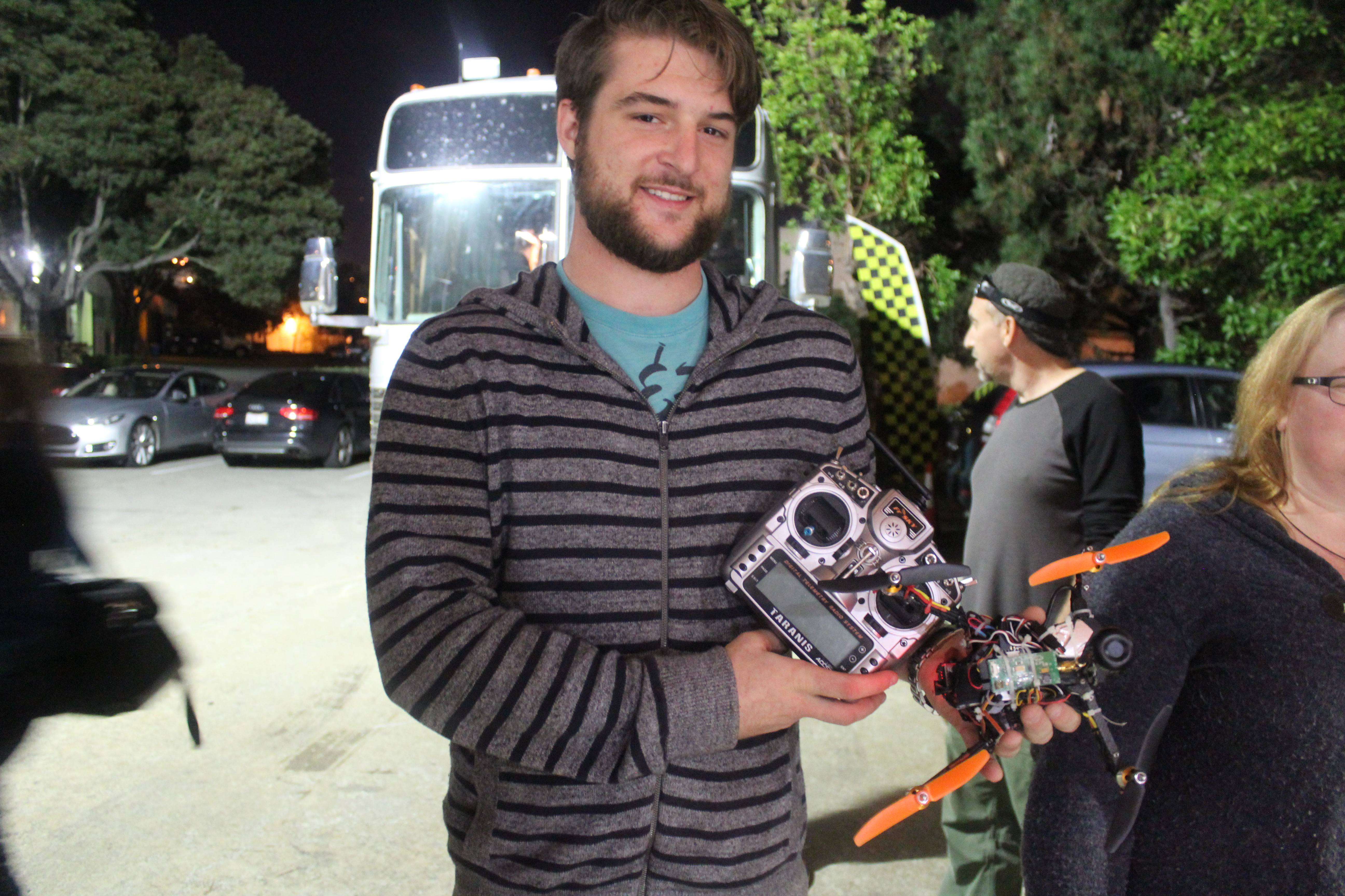 Kurt, a Silicon Valley software engineer, shows off his homemade mini-drone outside the fight club space. (Phoebe Barghouty/Peninsula Press)