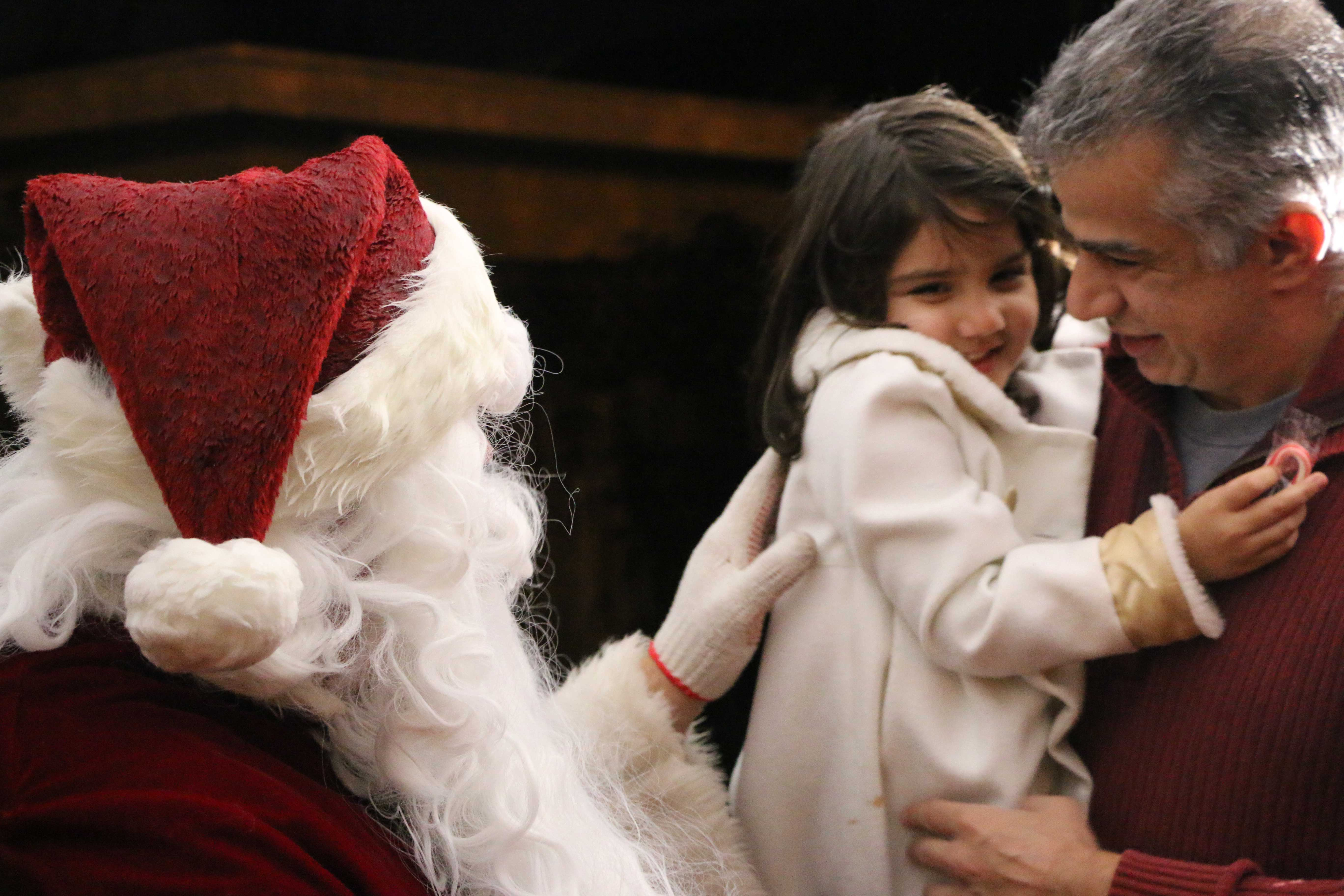 Eight-year-old Mikayla Chabra, too shy to sit in Santa's lap, said the only thing on her Christmas list is a pair of ballet shoes. (Phoebe Barghouty/Peninsula Press)