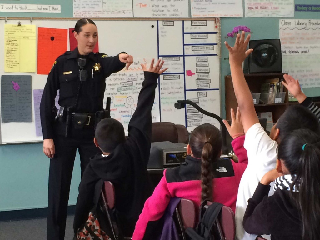 Officer Mary Ferguson visits fourth graders at Belle Haven Elementary on Nov. 19, 2014. Ferguson is working to improve the Menlo Park Police Department's relations with the community and keep local youth out of gangs. (Farida Jhabvala Romero/Peninsula Press)