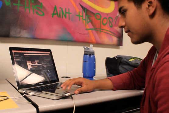High school senior Sergio Flores highlights his passion for moviemaking on Ambition Spotlight at the StreetCode Academy headquarters in East Palo Alto. (Sabrina Elfarra/Peninsula Press)
