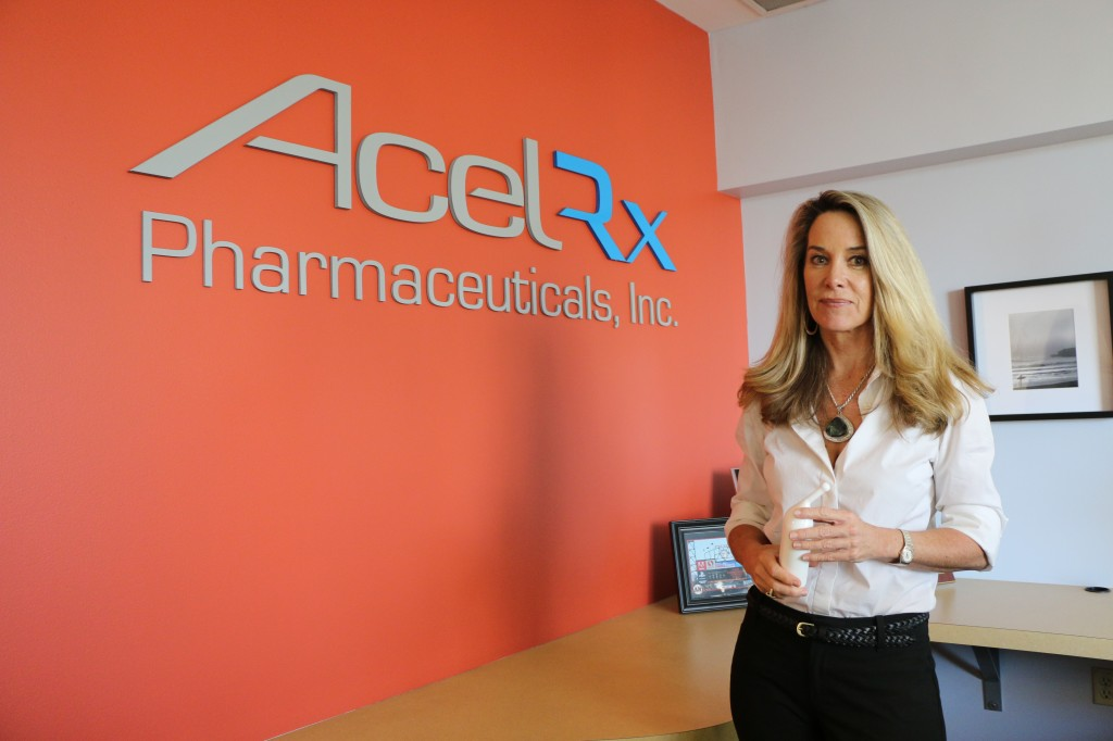 AcelRx Founder and Chief Medical Officer Dr. Pamela Palmer holds a Zalivso product replica in the Redwood City-based company headquarters.