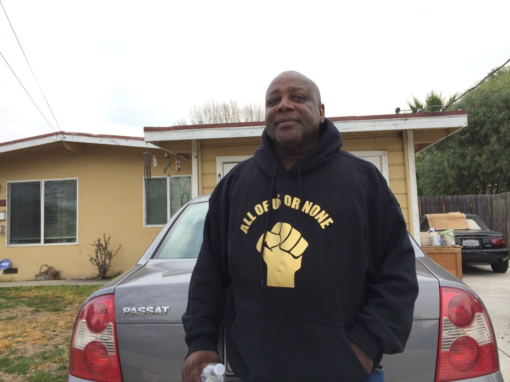 Dorsey Nunn stands in front of his house in Belle Haven on Jan. 16, 2015. Nunn's parents purchased the property in 1968. He estimates the three-bedroom house is now worth over $570,000, in part thanks to its proximity to Facebook. (Farida Jhabvala Romero/Peninsula Press)