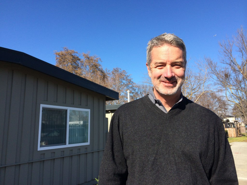 Matt Franklin, president of MidPen Housing Corporation, oversees an affordable housing property in Belle Haven on Jan. 20, 2015. MidPen plans to build 78 new apartments for low-income residents in Belle Haven with funding from the city. (Farida Jhabvala Romero/Peninsula Press)