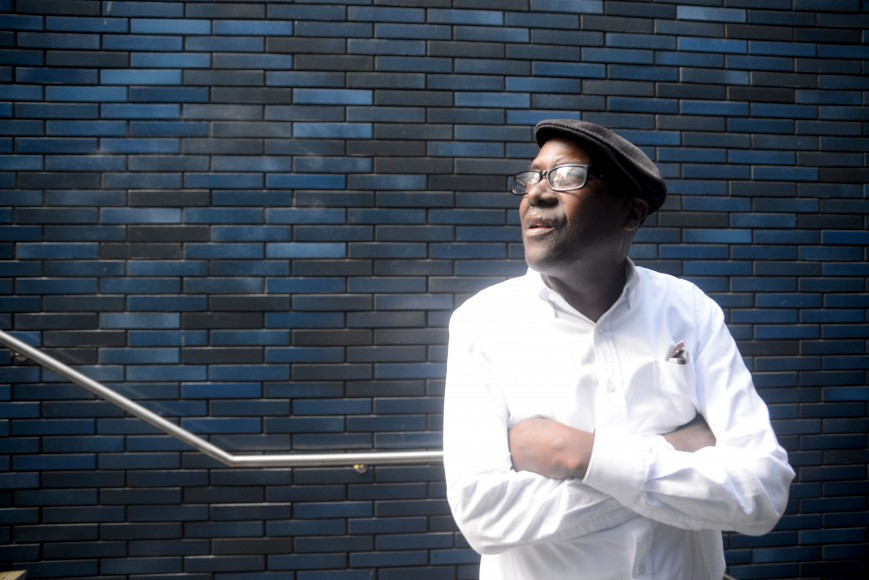 Mr. Maurice, a friend of Evans', pauses to gather his thoughts in downtown Oakland. (Travis Shafer/Peninsula Press)