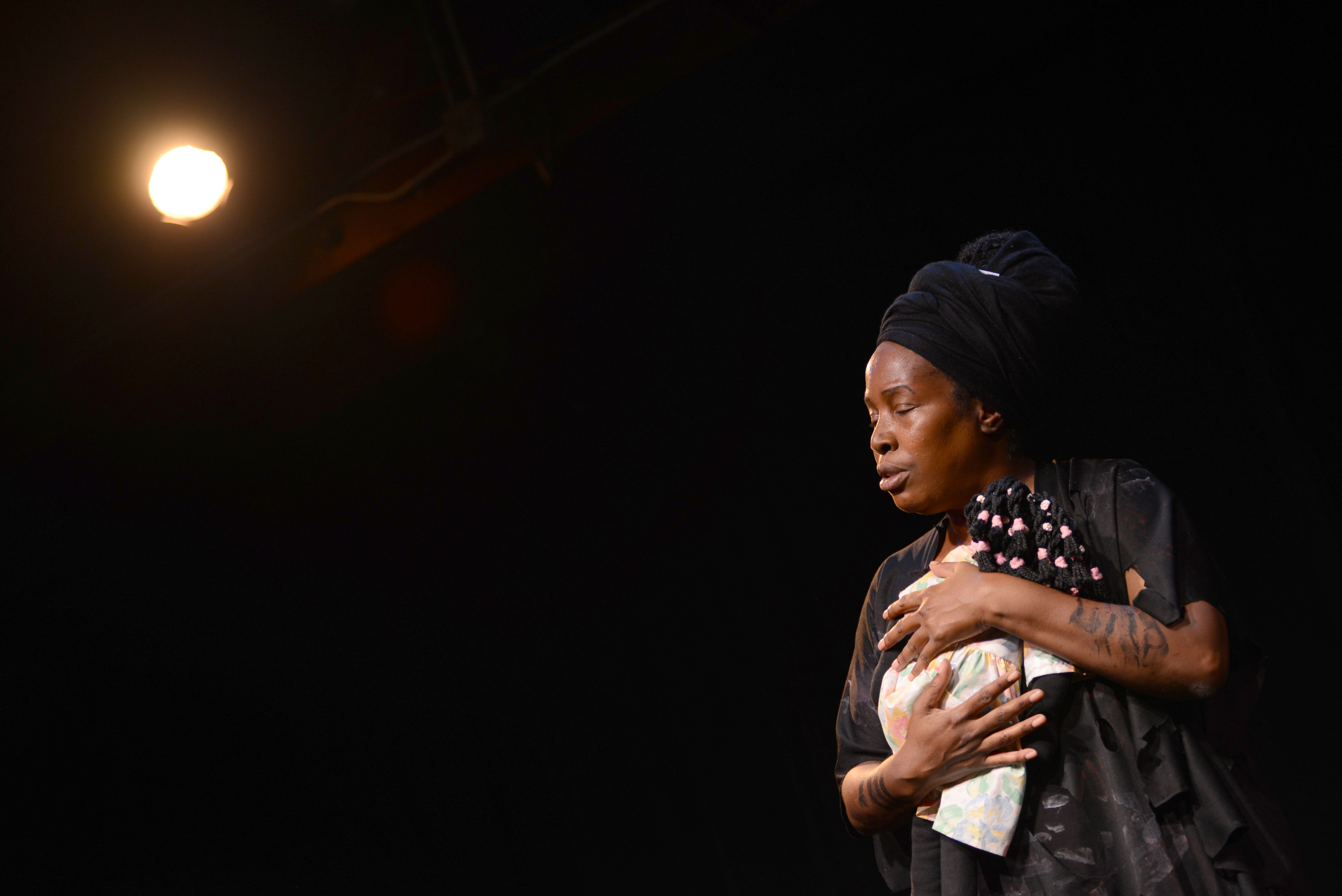 Regina Evans performs her piece '52 Letters' at the Marsh in San Francisco.  (Travis Shafer/Peninsula Press)