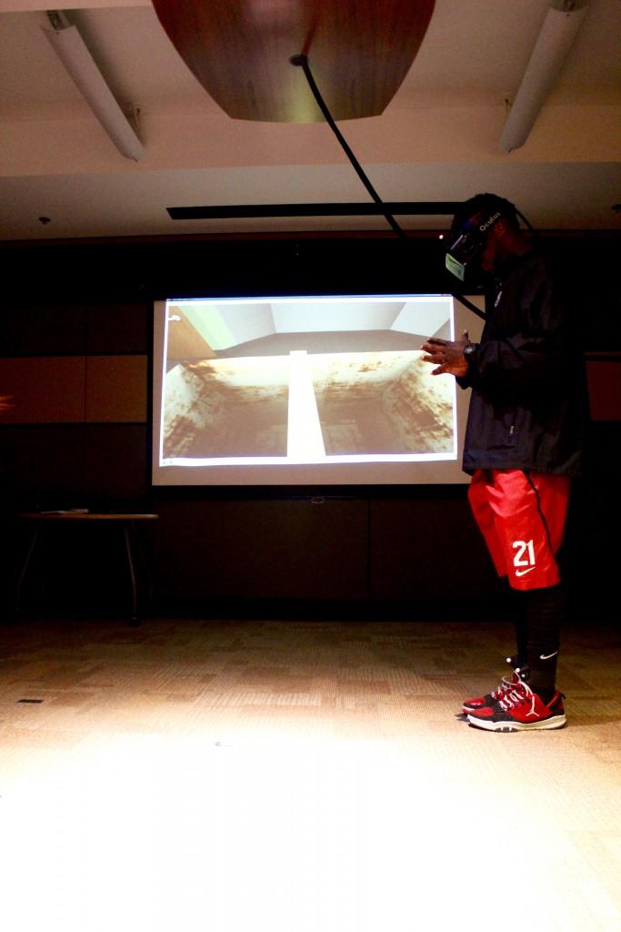 Ronnie Harris steps onto the virtual plank in the Stanford virtual reality lab. (Naomi Cornman/Peninsula Press)