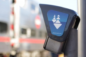 A Caltrain passes by a Clipper card reader at the Palo Alto Transit Center on October 20, 2015. Caltrain is considering increasing fares and parking fees. (Jeff Barrera/Peninsula Press)