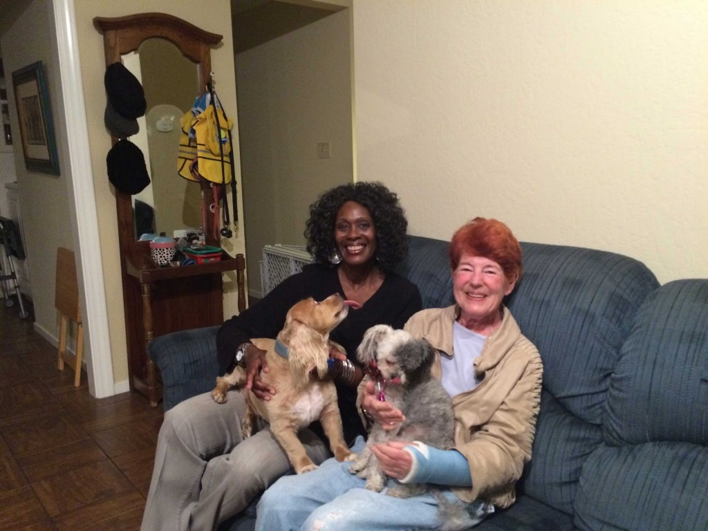 Kim Hester, left, and her two dogs, Freckles and Fluffy, moved in with retiree Pat Boyd, right, in October 2015. Hester plans to remain in Boyd's San Mateo home until she retires to Alabama in two or three years. (An-Li Herring/Peninsula Press)