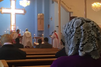 Parishioners worship at Mar Yosip Assyrian Church of the East in Nov. 2015. Assyrians -- one of the Middle East's oldest ethno-religious groups -- now face extinction at the hands of the Islamic State. (Kaitlyn Landgraf/Peninsula Press)