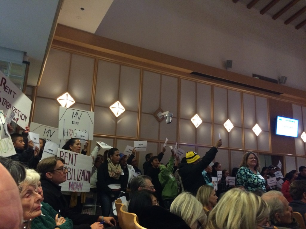 Dozens of the Mountain View Tenants Coalition members demonstrated continued support for rent stabilization and just-cause eviction policies at the Mountain View City Council meeting on Dec. 1, 2015. The city council rejected both policies at an Oct. 19 study session. (An-Li Herring/Peninsula Press)