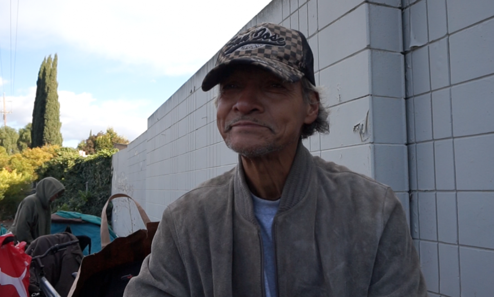 """Jerry Miranda, who lived in """"The Jungle,"""" now has an apartment. He spends much of his time with friends who are unsheltered. (Jamie Stark/Peninsula Press)"""
