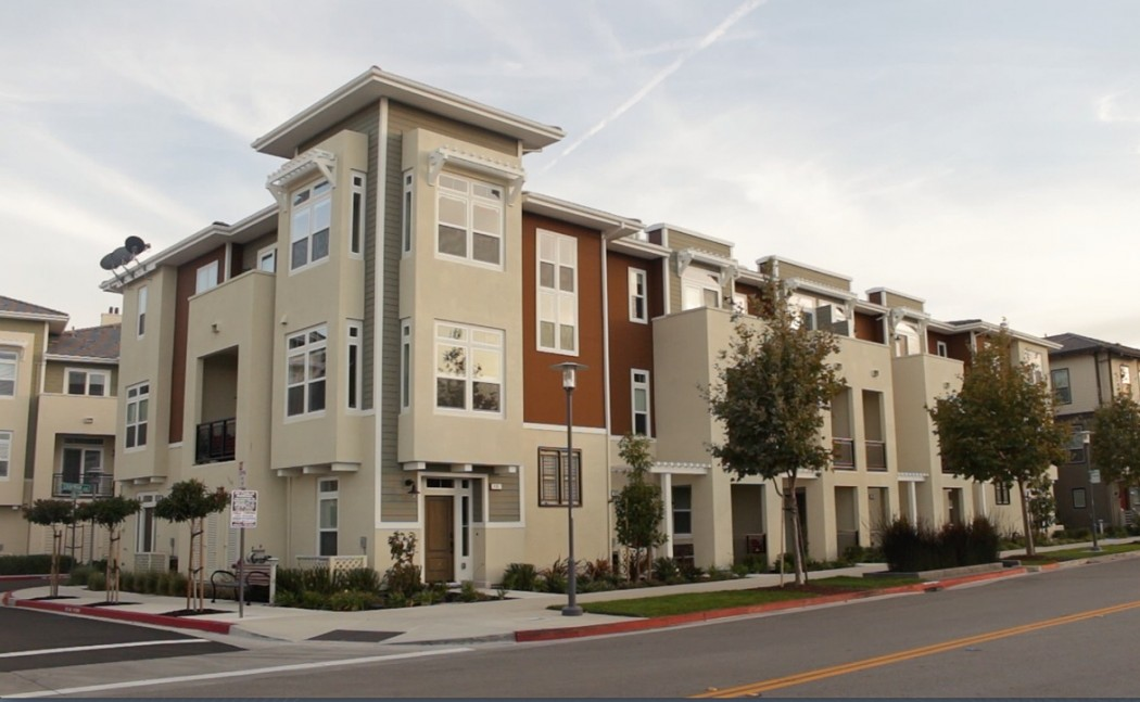 An apartment complex in the Bay Meadows development in San Mateo, Calif. In response to In response to skyrocketing rents and gridlocked freeways, policy experts are pushing for more transit-oriented projects like Bay Meadows. (Jeff Barrera/Peninsula Press)