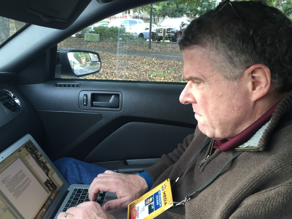 Peter King types his notes after leaving Broncos practice at Stanford Stadium on Feb. 3, 2016. (Shane Newell / Peninsula Press).