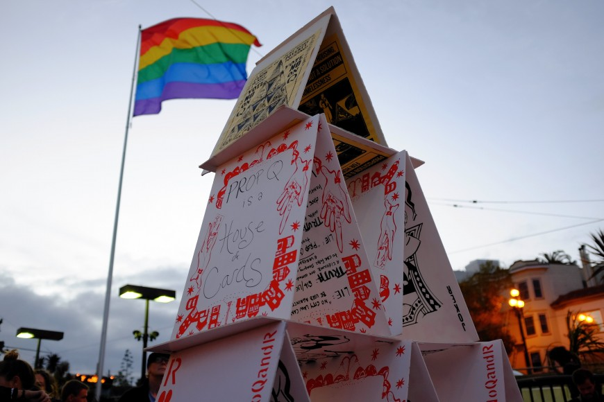 Activists construct an 8-foot house of cards at a rally against Prop Q on Castro Street Thursday, Oct. 13, 2016. Critics of Prop Q say it offers no new housing for the city's estimated 6,700 homeless. (Peter Arcuni/Peninsula Press)