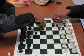 Students play chess to begin their day in the classroom.