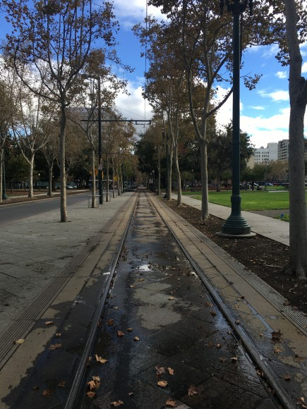 San Jose's light rail train runs through the middle of St. James Park, separating the two sides. (Tara McCullough/Peninsula Press)