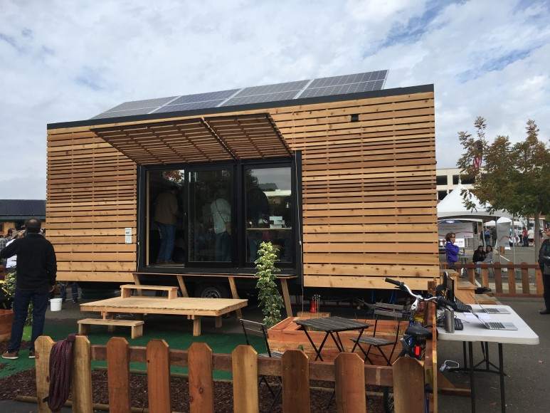 Tiny House in My Backyard presented by UC-Berkeley. This 196-square-foot house was designed for a newlywed, environmentally conscious couple purchasing their first home in the East Bay, and it is the pilot unit in a community of zero-net energy Tiny Houses to be established in Richmond, California. Heat pump water and space heating, rainwater collection and human waste composting help the house to cost-effectively minimize its life cycle emissions. (Siqi Lin/Peninsula Press)