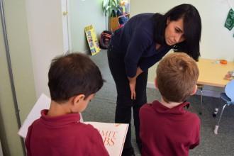 Desiree Balzaretti, a teacher at Casa dei Bambini Montessori school, talks with a student on Nov. 1, 2016. (Erica Evans/Peninsula Press)