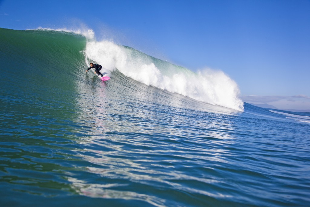 Big-wave surfer Bianca Valenti catches a wave at Ocean Beach, San Francisco. Nov. 28 2014 (Sachi Cunningham)