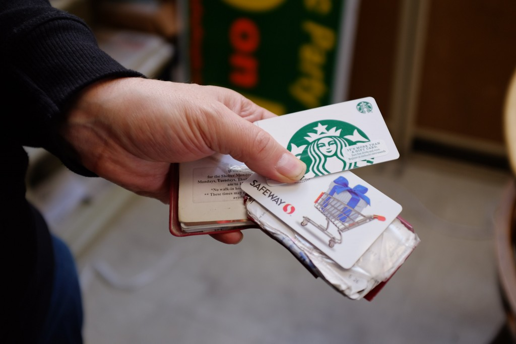 TJ Johnston holds the gift cards he earns for his work at Street Sheet