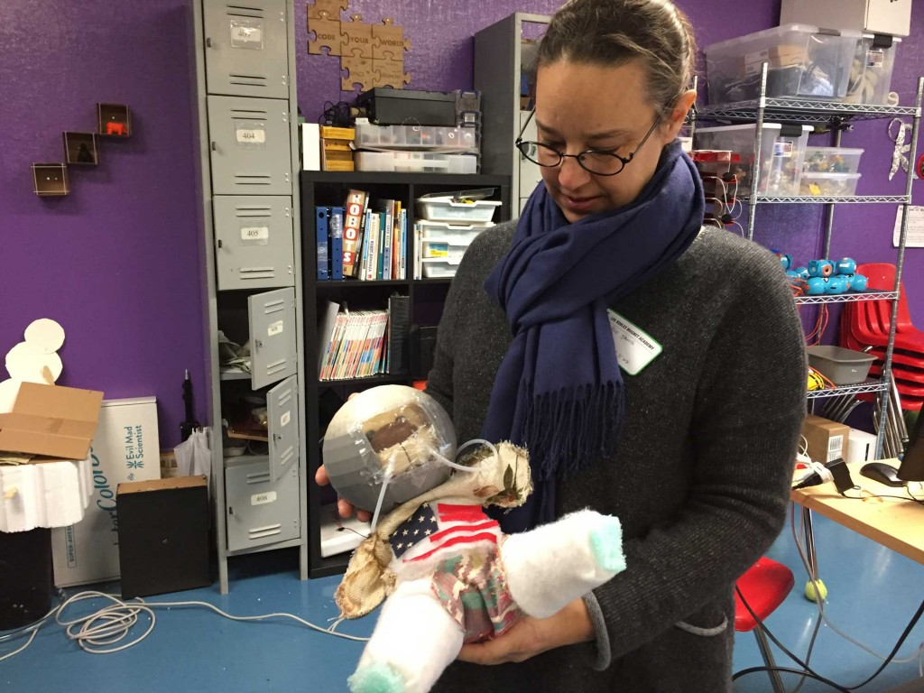 """Nico Janik oversees the Ravenswood district's """"makerspaces,"""" where kids can build robots, use 3D printers and create spacesuit prototypes, such as this one. (Ashley Gross/Peninsula Press)"""