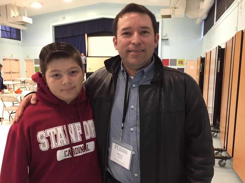 Marco Duarte (right) is president of the District Advisory Committee in the Ravenswood district. He has three kids in the school system, including Noel, a sixth grader. (Ashley Gross/Peninsula Press)