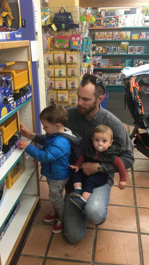 Matt Dolkas, who used to bike to the store to buy firecrackers as a kid, now brings his two sons. (Sasha Landauer/Peninsula Press)