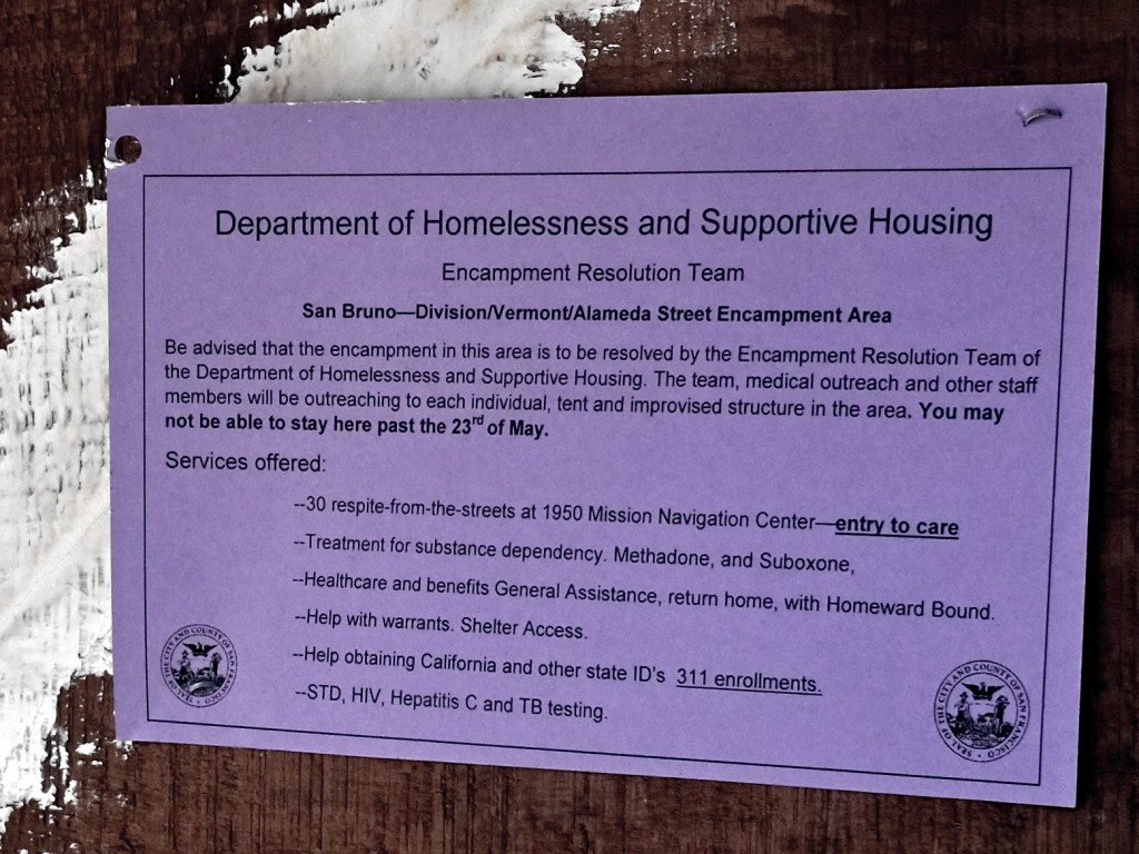 An eviction notice from the Encampment Resolution Team announces a camp clearing. (Peter Arcuni/Peninsula Press)
