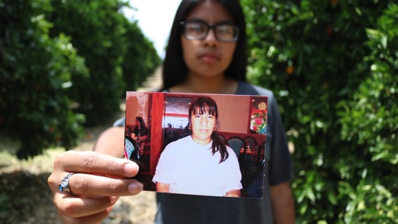 Leticia Lopez (above) holds a photo of her mother, Graciela Lopez, who is currently serving 10-year Bar Sentence from the U.S. for unlawful presence. After the completion of her sentence, in 2019, Lopez hopes her family will be able to reopen her mother's application for residency. Photo taken in Porterville, California on Monday, May 15, 2017.  (Bethney Bonilla/Peninsula Press)
