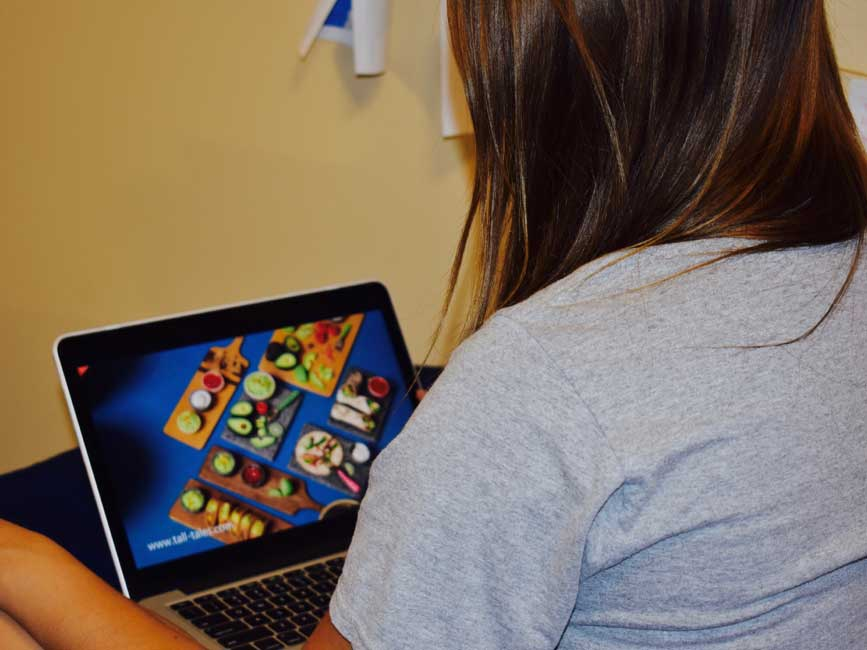 Stanford student Madison Perez watches a video about miniature food on June 5, 2017. These tutorials are some of the most popularly shared on Facebook and other social media sites. (Meg McNulty/Peninsula Press)