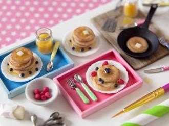 "A photo of miniature stacks of American pancakes created by Caroline McFarlane-Watts. McFarlane-Watts has ""created videos showing both the process of creating such miniatures and videos which parody recipe videos."" (Photo courtesy of Caroline McFarlane-Watts/Tall Tales Productions)"