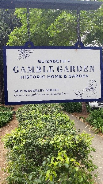 Gamble Garden's sign hangs outside one of its entrances, marking one of the many small pathways into the garden. (Ethan Cruikshank/Peninsula Press)