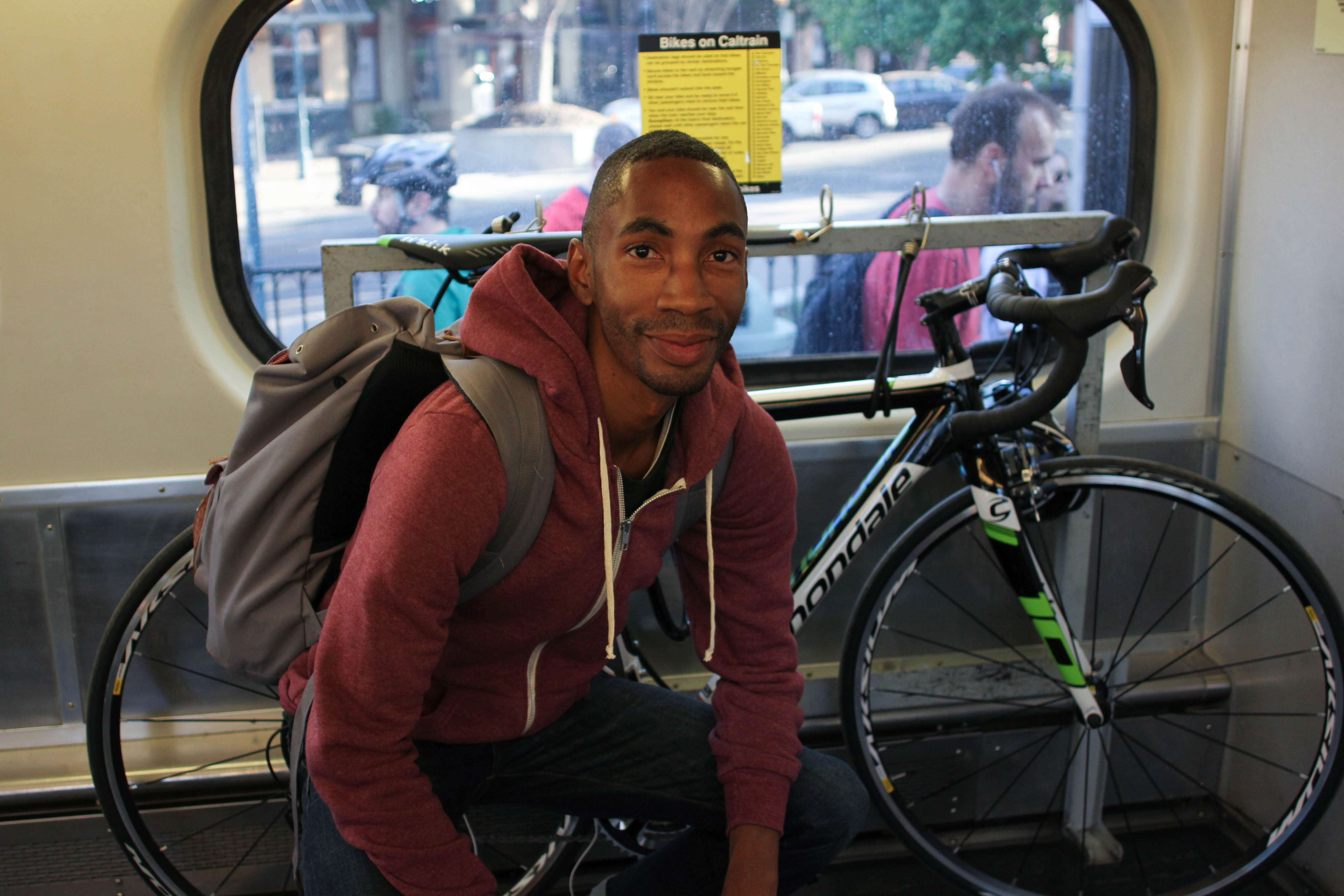 """Alan Nolley is riding Caltrain from Santa Clara to San Francisco on the morning of Sept. 29. Alan used to drive his car to Walnut Creek every morning. After changing jobs, he now commutes by train and bike. """"It's a more efficient, cleaner and greener way to work,"""" Alan says. (Charlotte Kosche/Peninsula Press)"""