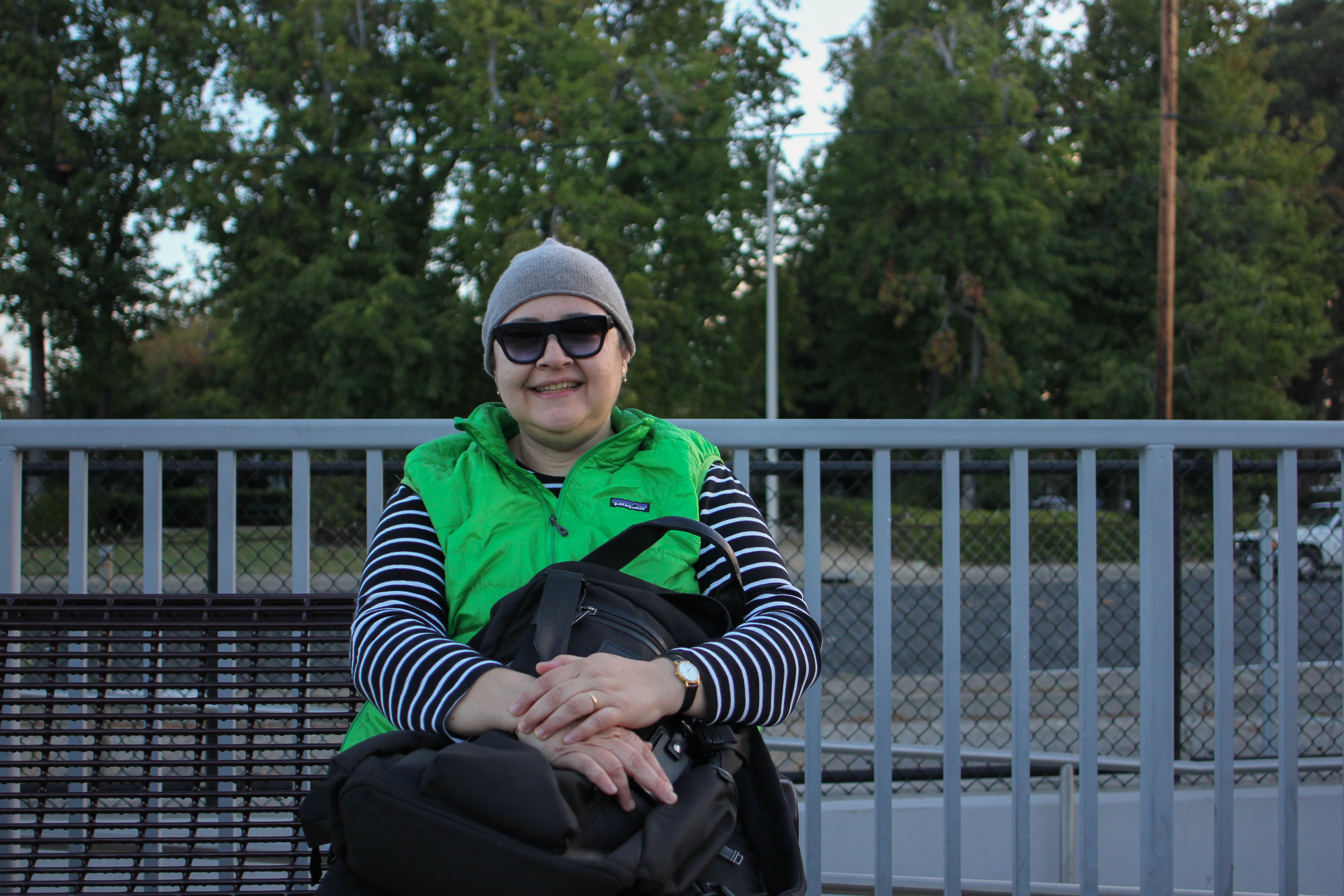 """Monica Stein is waiting for the northbound Caltrain at California Avenue station on the morning of Sept. 29. Monica rides the train a few times per month in order to go to the city. """"It's just more feasible (than going by car),"""" she says. """"And there are no parking fees."""" (Charlotte Kosche/Peninsula Press)"""