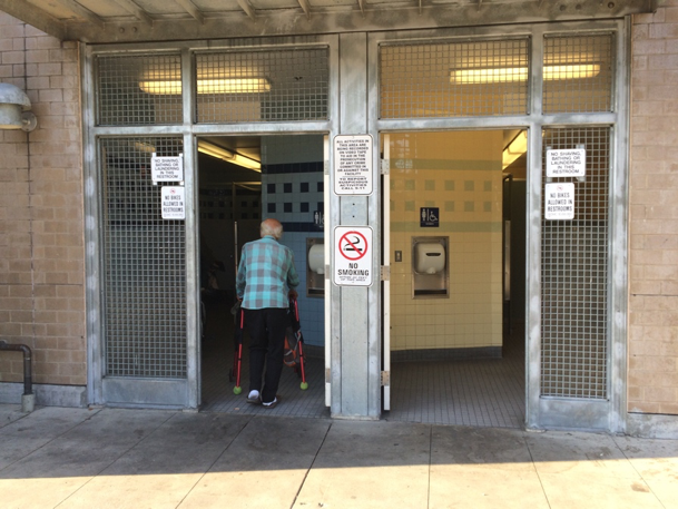 An elderly man enters a public restroom in downtown Santa Cruz. This restroom, located at the Soquel Front garage at 601 Front Street, is open to the public from 8am-11pm everyday.   (Mark Lieber/Peninsula Press)
