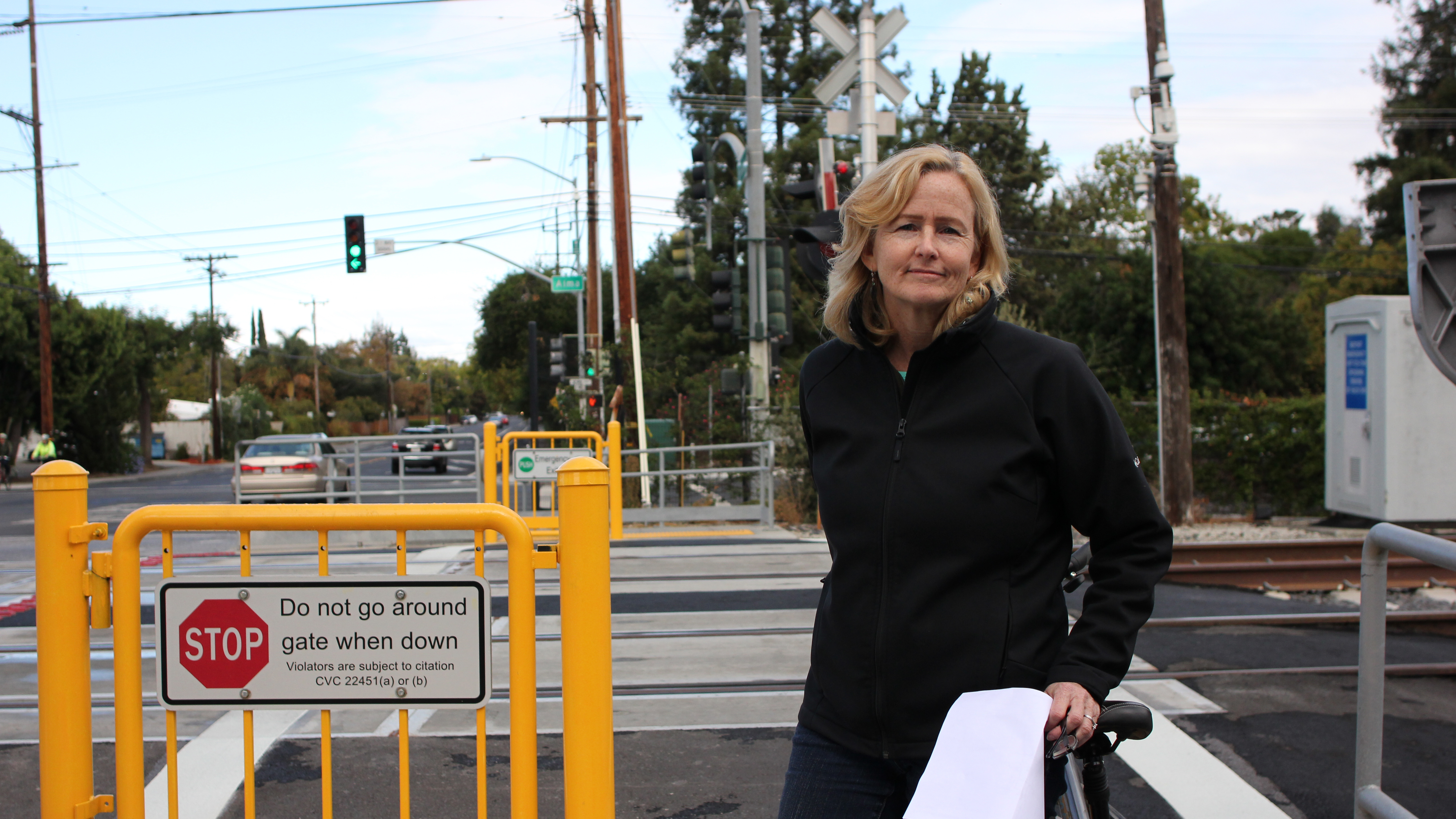 Palo Alto resident Penny Ellson frequently rides her bicycle across the tracks at Charleston Road and Meadow Drive. (Charlotte Kosche/Peninsula Press)