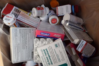 A pile of prescription drugs and over-the-counter medicine.