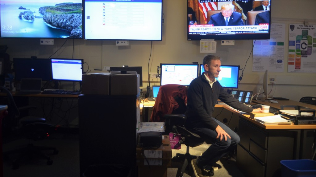 Nathan Rainey, Emergency Services Coordinator of Palo Alto, checks alert systems at his office.