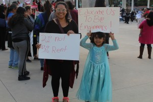 San Jose resident Angelica Florez stands outside City Hall with her daughter, Mia, during the Somos San Jose march. (Isha Salian/Peninsula Press)