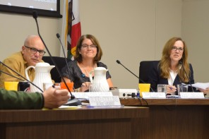 Interim Superintendent Karen Hendricks, right, addresses parents at the Palo Alto Unified School District board meeting on Oct. 10.