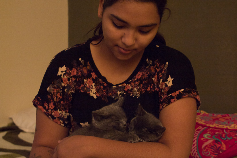 Jaritza cuddles two of the three family kittens. Like Alexa, Jaritza also loves her cats. Her husband often complains that Alexa and Jaritza love the cats more than him.